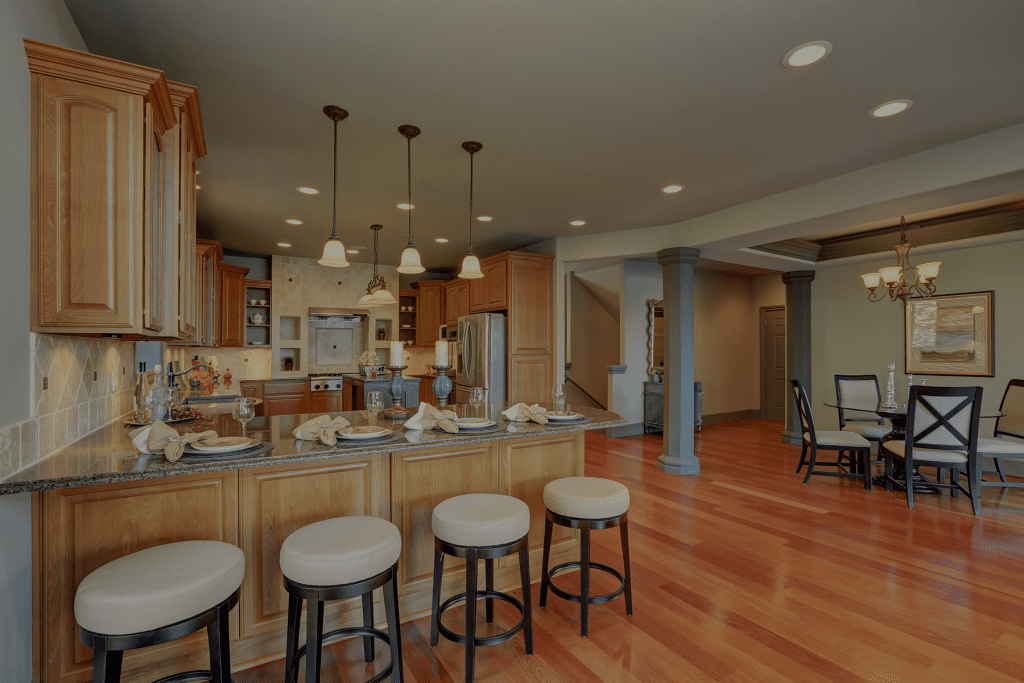 Kitchen remodeling with beautiful hardwood floors and light colored cabinets