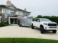 New home constructed with truck and trailer in driveway