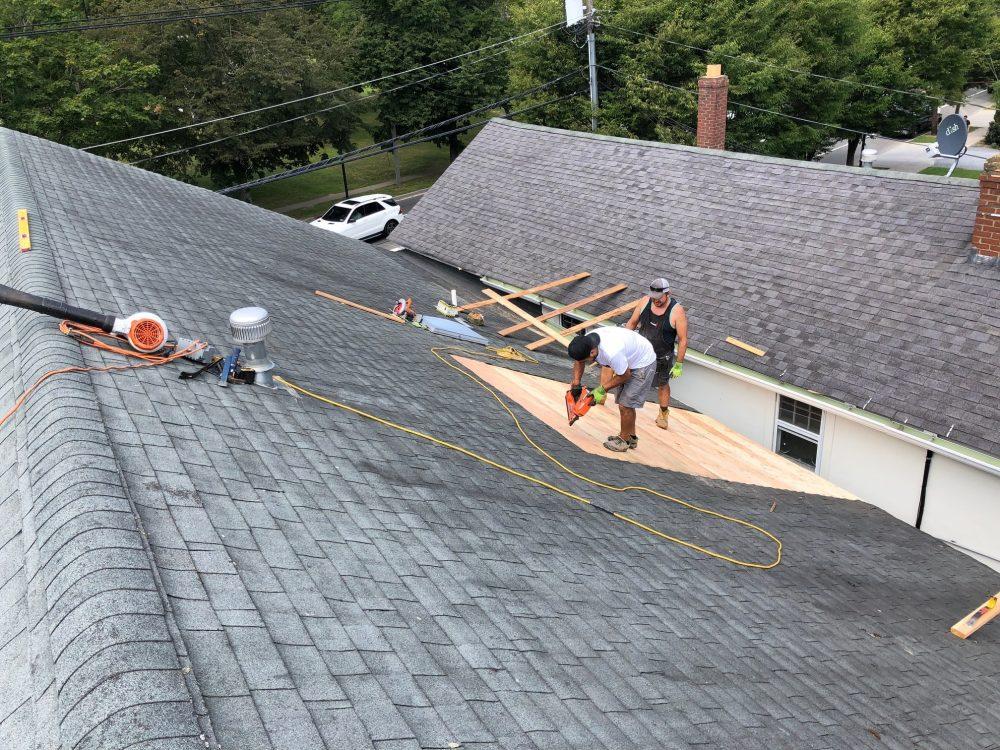 Crew members installing roofing