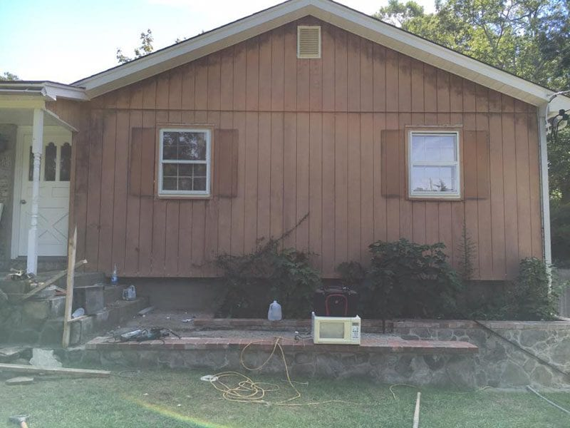 Home with vinyl siding and fading paint